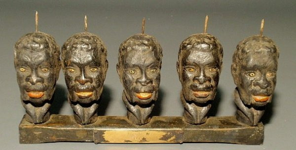 12: Five carved and painted African American heads mou