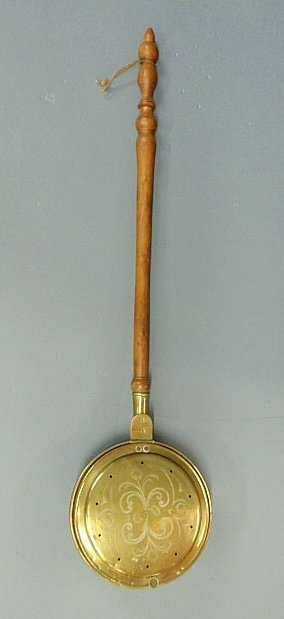 14: Brass bed warmer, early 19th c., with a turned map