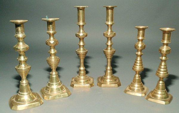21: Three pairs of Victorian style brass candlesticks,