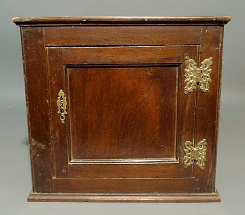 23: English oak hanging cabinet, 19th c., with recesse