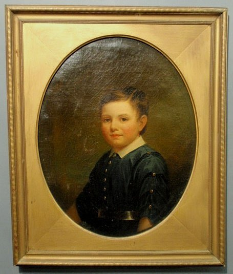 24: Oil on canvas portrait of a young boy signed verso