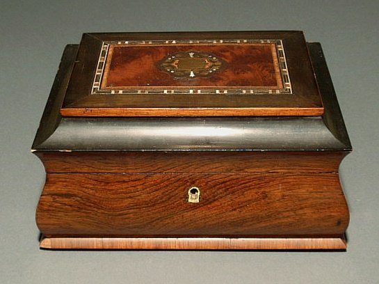 7: Rosewood music box with brass and mother-of-pearl