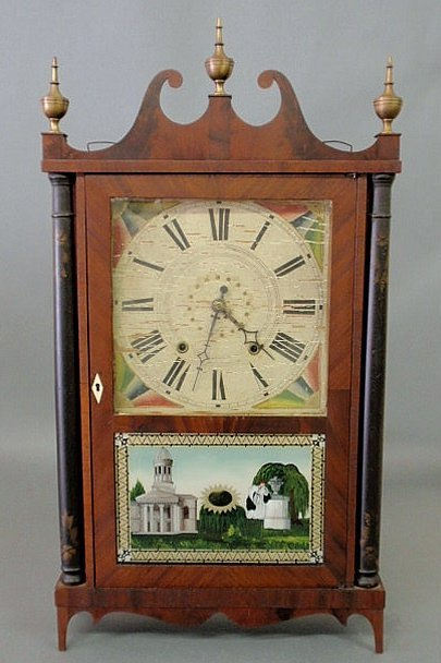 """20: Pillar and scroll clock with paper label signed """"E"""