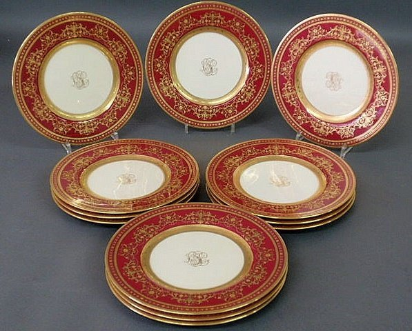 22: Set of twelve Minton service plates with maroon bo