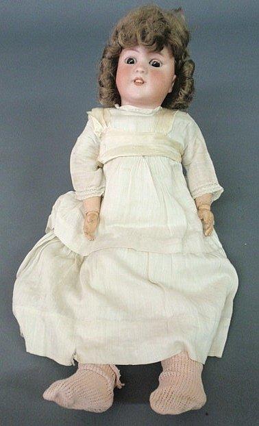 "46: Simon & Halbig bisque head doll. 22""h."