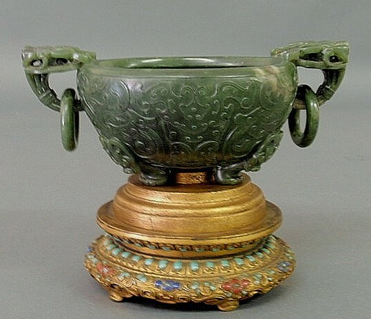 88: Carved spinach green jade bowl on a gilt decorated
