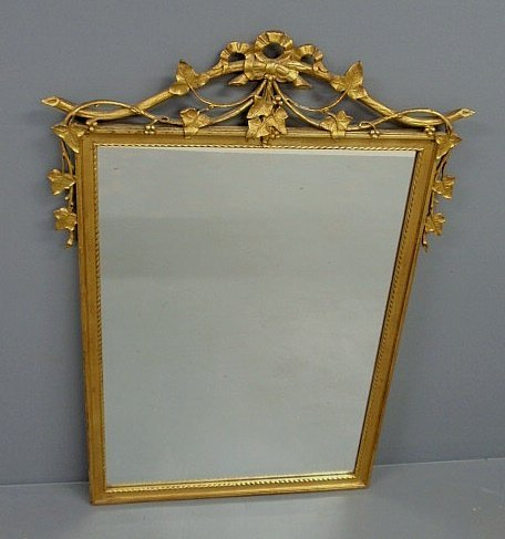 221: Gilt framed mirror with leaf and scroll decoration
