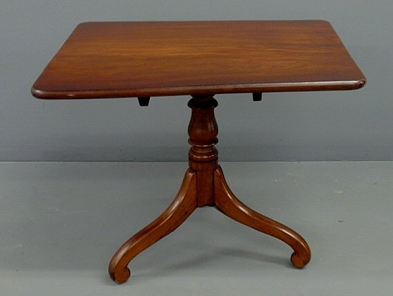 "226: Empire mahogany low table with a tilt top. 25""h.,"