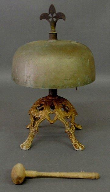 249: Cast iron and brass dinner bell with fleur-de-lis