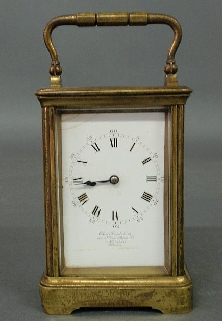580: French brass carriage clock with beveled glass, fa
