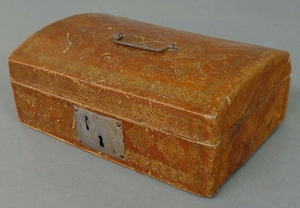 "23: Leather box, 19th c., with a dome lid. 4""h.x10""w.x"