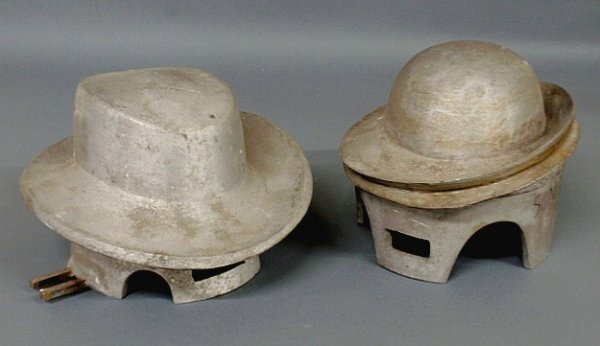 24: Two French Deco hat molds, cast aluminum. Approx.