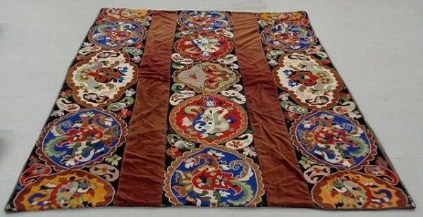 6: Colorful wall hanging/spread with three large need