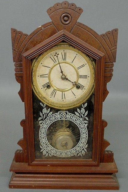 11: Carved walnut shelf clock by Waterbury Clock Co. 1
