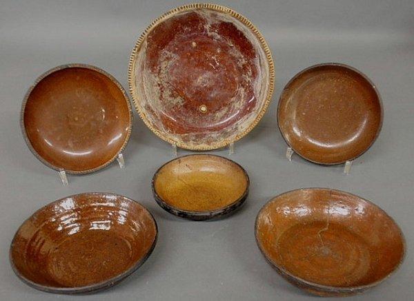 12: Five Pennsylvania redware pie plates, 19th c., eac