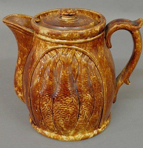 15: Large Rockingham type pitcher with fish decoration