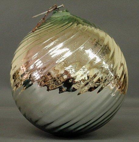 "18: Silver swirl glass witch's ball. 12""h.x12""dia."