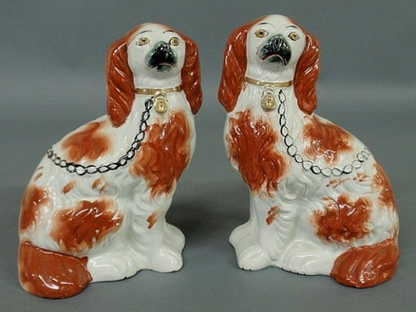 24: Pair of Staffordshire seated red Spaniels, c.1860.