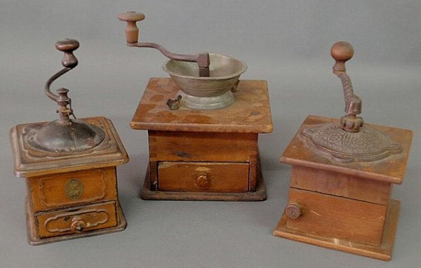 27: Three coffee grinders to include one with a pewter