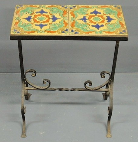 256: Wrought iron garden table with a double-tile top.