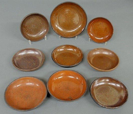 259: Nine 19th c. Pennsylvania redware pie plates, larg