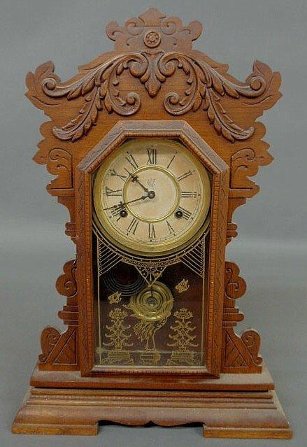 261: Carved oak gingerbread mantel clock by Waterbury C