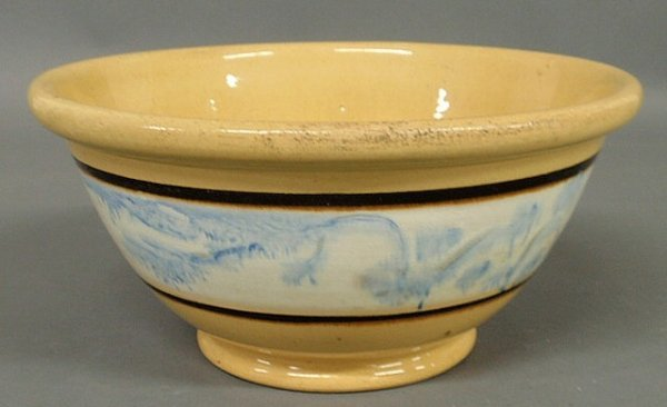 263: Yellow ware bowl with blue glaze decorated collar.