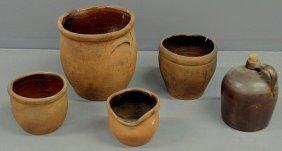 "266: Four redware jars, largest 12.5""h., and a jug 11""h"