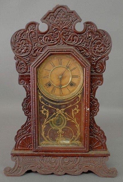 268: Carved oak gingerbread mantel clock by Waterbury C