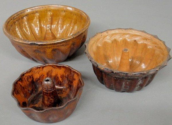 "272: Three redware Turk's head molds, 19th c. 10"", 8"","