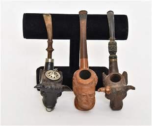 Three Carved Smoking Pipes