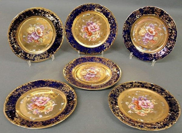 8: Set of six Austrian plates with floral and gilt de
