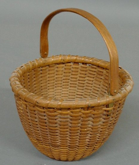 17: Delicate woven Nantucket Lightship basket, 20th c.