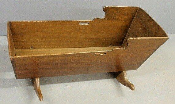 "6: Pine cradle, c.1800, stained walnut. 24""h.x43""l.x2"