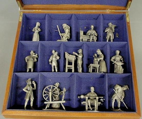 15: Mahogany cased set of thirteen pewter 18th c. trad