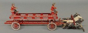 18: Cast iron toy horse-drawn fireman's ladder wagon.