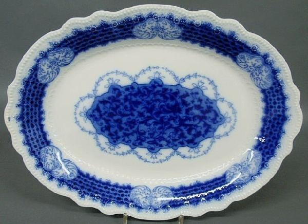 "28: Oval Flow Blue platter, 19th c. 20""x15"