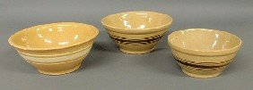 "Three Yellowware Mixing Bowls- 4.5""h.x10.75""dia.,"