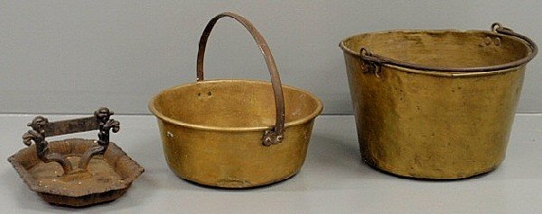 "16: Two brass buckets, largest 11""h. and a cast iron b"