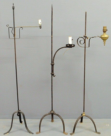 22: Three wrought iron standing floor lamps, each appr