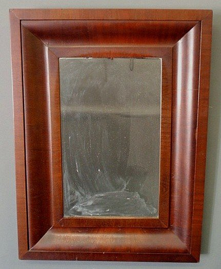 "23: Empire mahogany veneered mirror. 25.5""x19"""