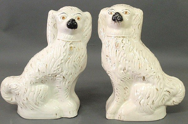 24: Two large Staffordshire seated white spaniels, c.1