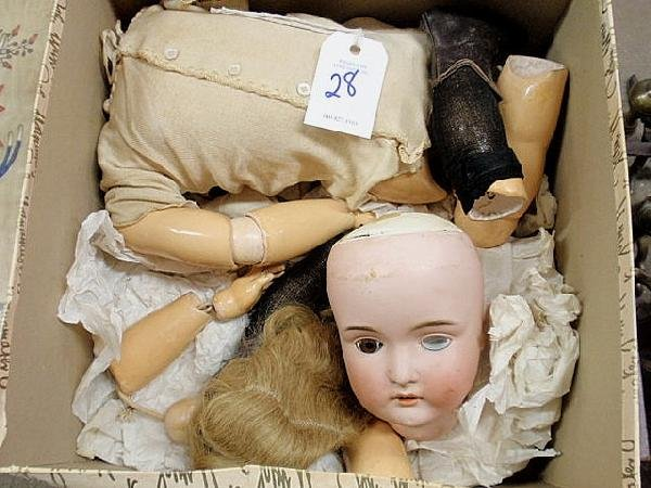 28: German bisque head doll with composition body, dis
