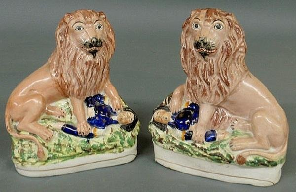 161: Rare pair of 19th c. Staffordshire lions above a d