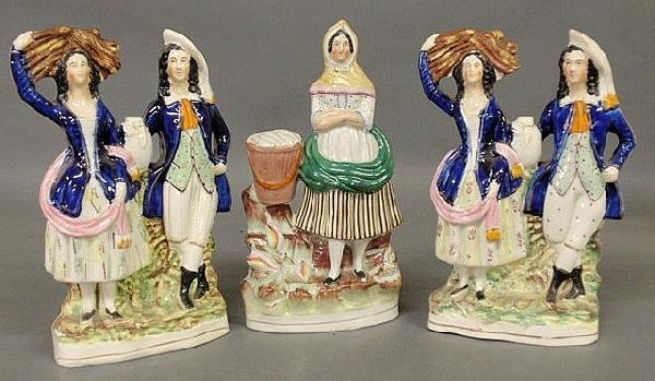 251: Staffordshire fishwife figural group and two wheat