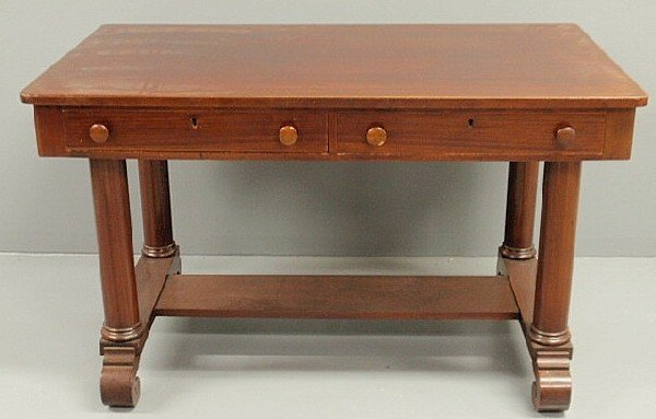 260: Empire style mahogany desk with column form legs a
