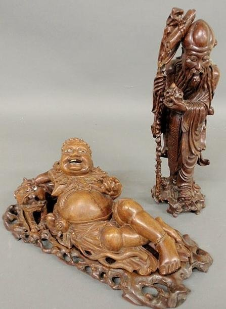 264: Two Asian carved exotic wood figures, one reclinin