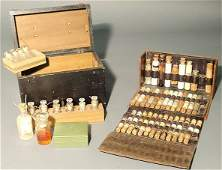 242: Black wood cased medical science kit with assorted
