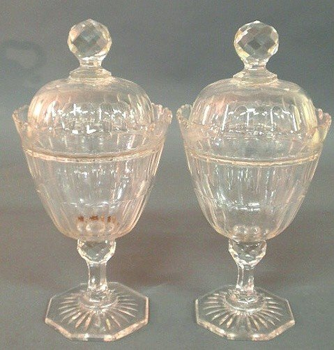 12: Pair of crystal glass covered urns with faceted fi