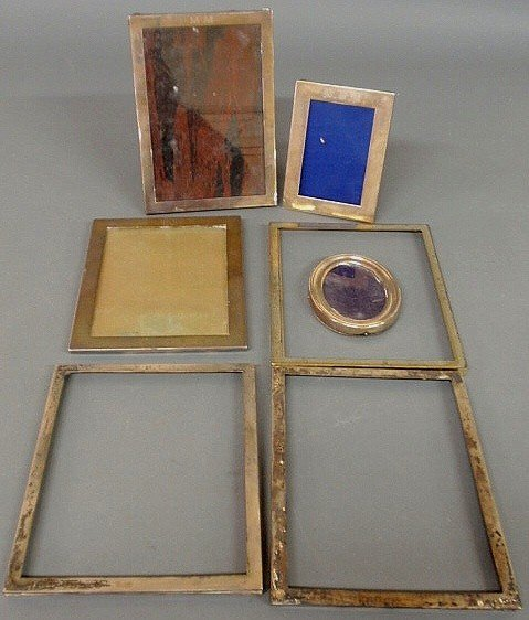 "93: Seven sterling silver picture frames, largest 10""x"